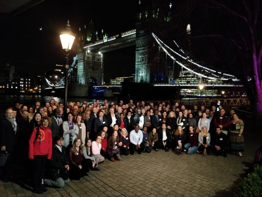 Attendees of the IVVN 2019 conference standing in front of London's Tower Bridge at night