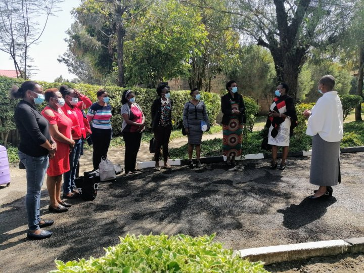 IVVN outreach team standing outside Naivasha Girls Secondary School before the workshop