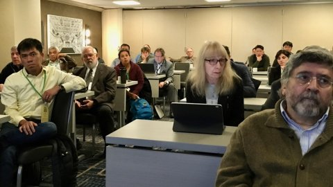 Photo of a group of people listening to a seminar